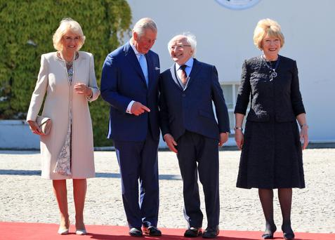 Prince Charles and his wife Camilla pose for a picture with President Michael D Higgins and his wife Sabina Photo: Collins