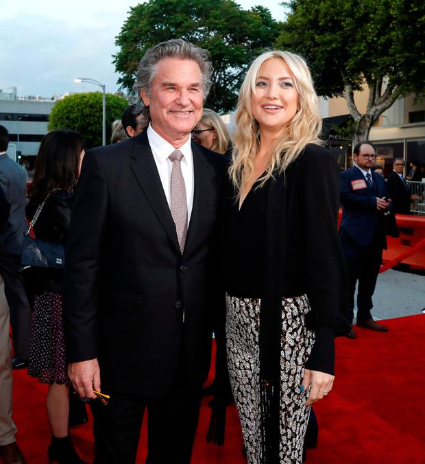 Actors Kurt Russell and Kate Hudson pose at the premiere of the movie