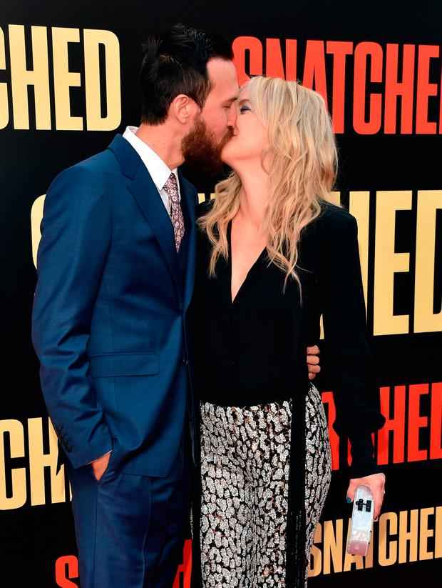 Musician Danny Fujikawa (L) and actor Kate Hudson attend the premiere of 20th Century Fox's