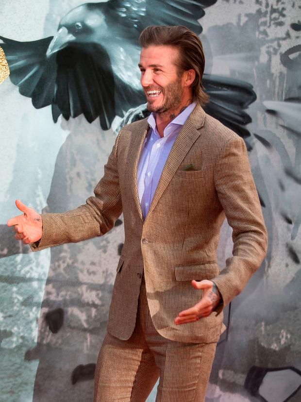 Former England football captain David Beckham poses for a photograph upon arrival at the European Premiere of