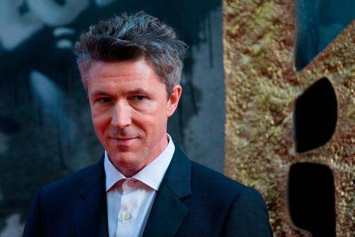 Irish actor Aidan Gillen poses for a photograph upon arrival at the European Premiere of