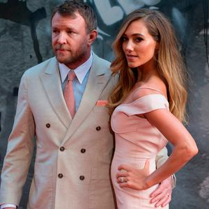 British director and producer Guy Ritchie (L) and English model Jacqui Ainsley pose for a photograph upon arrival at the European Premiere of