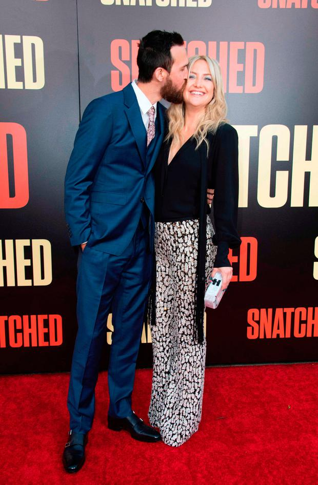 Danny Fujikawa (L) and actress Kate Hudson attend the world premiere of