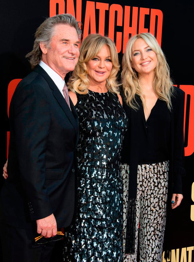 (L-R) Actors Actor Kurt Russell, Goldie Hawn and Kate Hudson attend the world premiere of