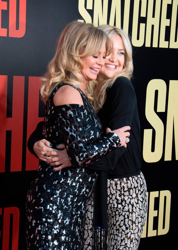 Actresses Goldie Hawn (L) and Actress Kate Hudson attend the world premiere of