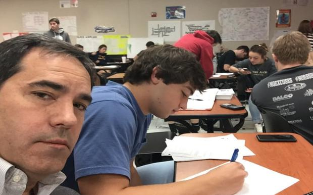 A father embarrassed his son by turning up to his class. Credit: Twitter / @mollih04