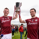 Joe Canning, left, and captain David Burke of Galway celebrate with the cup after the Allianz Hurling League Division 1 Final match between Galway and Tipperary