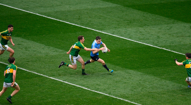 Paddy Andrews of Dublin is surrounded by Kerry players during the League final