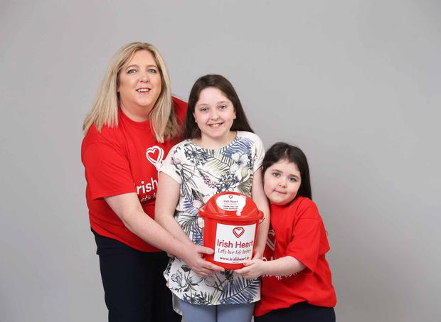 Lucinda McNerney pictured with her daughters Aoife (12) and Dervla (6)