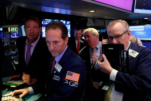 Traders gather at the post where Snap Inc. is traded, just before the opening bell on the floor of the New York Stock Exchange (NYSE)