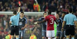 Romanian referee Ovidiu Hategan (L) shows a red card to Celta Vigo's Argentinian defender Facundo Roncaglia (2nd L) and Manchester United's Ivorian defender Eric Bailly (C AFP PHOTO / Miguel RIOPA