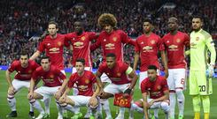 Manchester United players line up for a group photograph ahead of the UEFA Europa League semi-final, second-leg football match between Manchester United and Celta Vigo at Old Trafford stadium in Manchester, north-west England, on May 11, 2017. / AFP PHOTO / Miguel RIOPA
