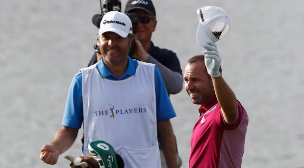 Sergio Garcia salutes the fans at Sawgrass after his moment of magic