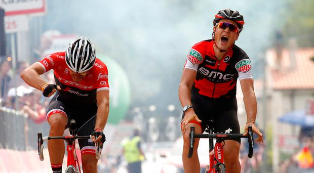 Swiss BMC rider Silvan Dillier (R) celebrates as he crosses the finish line to beat Belgian rival Jasper Stuyven by half the width of a wheel to win the sixth stage of the Giro d'Italia. Photo: Getty Images
