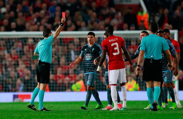 Manchester United's Eric Bailly and Celta Vigo's Facundo Roncaglia are both shown red cards by referee Referee Ovidiu Hategan. Photo: Reuters