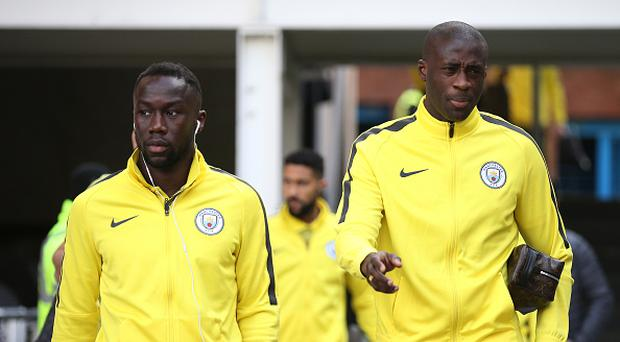 LONDON, ENGLAND - JANUARY 28: Bacary Sagna of Manchester City (L) and Yaya Toure of Manchester City (R) arrive prior to the Emirates FA Cup Fourth Round match between Crystal Palace and Manchester City at Selhurst Park on January 28, 2017 in London, England.