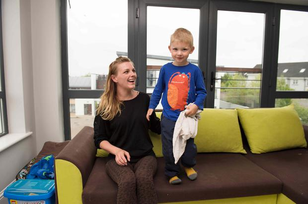 Izabela Tomas with her son Casper in her new home in Doughiska in Galway. Photo: Andrew Downes