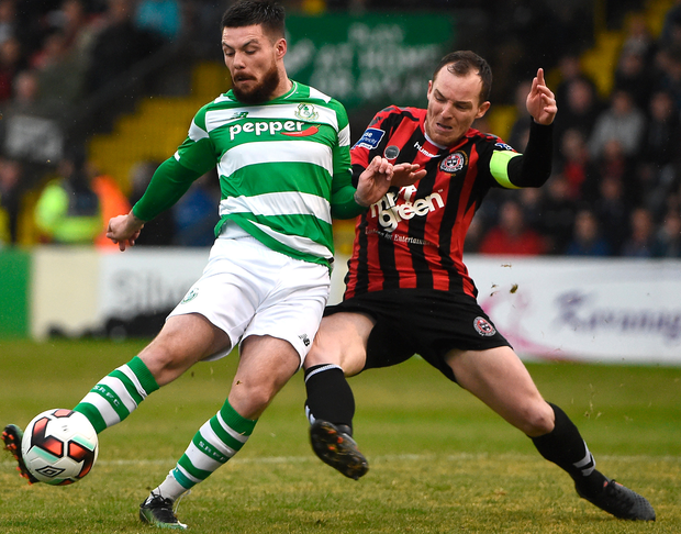 Brandon Miele of Shamrock Rovers shoots to score his side's first goal despite the attempts of Derek Pender of Bohemians. Photo: David Maher/Sportsfile
