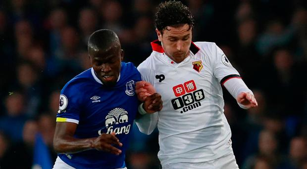 Watford's Daryl Janmaat in action with Everton's Enner Valencia.