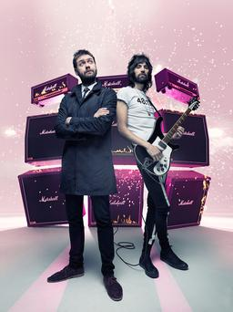 Singer Tom Meighan and guitarist Sergio Pizzorno of Kasabian
