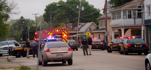Emergency personnel arrive to the scene of a shooting outside Pine Kirk nursing home in Kirkersville, Ohio on Friday, May 12, 2017. (Tom Dodge/The Columbus Dispatch via AP)