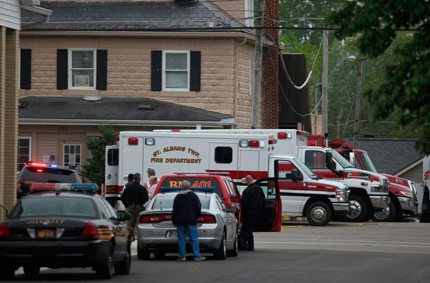 Emergency personnel arrive to the scene of a shooting outside Pine Kirk nursing home in Kirkersville, Ohio on Friday, May 12, 2017. (Doral Chenoweth III/The Columbus Dispatch via AP)