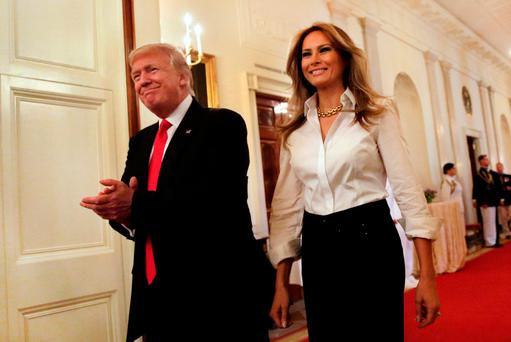 U.S. President Donald Trump and first lady Melania Trump arrive at a 'celebration of military mothers' event at the White House in Washington, U.S., May 12, 2017. REUTERS/Yuri Gripas