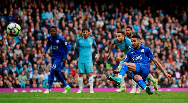 Leicester City's Riyad Mahrez scores from the penalty spot but it is disallowed for kicking the ball twice