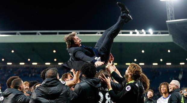 Chelsea manager Antonio Conte is thrown in the air by his players as they celebrate winning the Premier League title last night