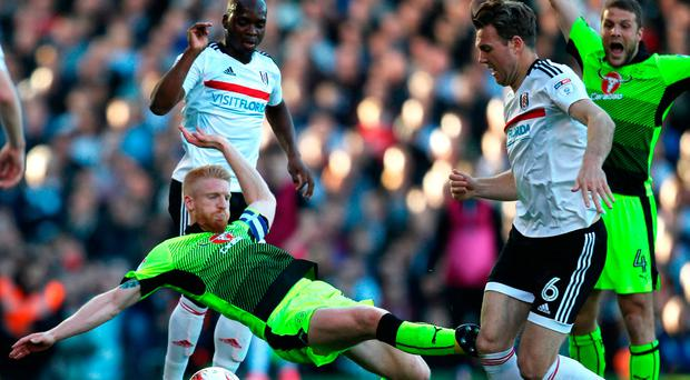 Paul McShane of Reading fouls Kevin McDonald of Fulham and is later sent off for the challenge