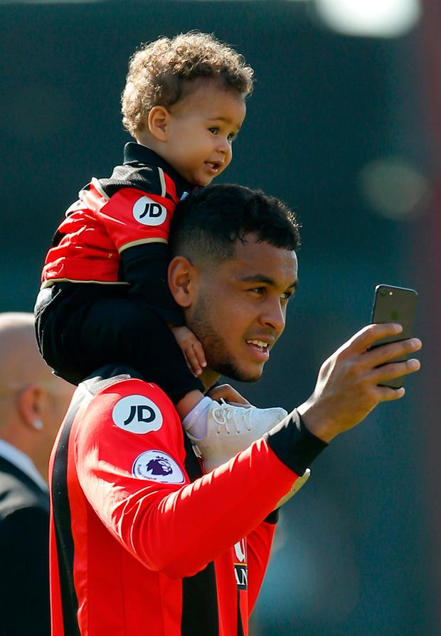 Bournemouth's Joshua King with his family during a lap of honour after the match. Photo: Reuters