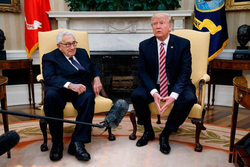 Pressure: US President Donald Trump (right) meets Henry Kissinger, Richard Nixon's former secretary of state and national security adviser Photo: Evan Vucci/AP