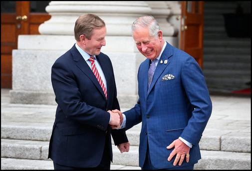 Support: Taoiseach Enda Kenny greets Britain's Prince Charles at Government Buildings. Photo: Steve Humphreys