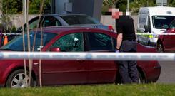 Drive-by: Gardai at the scene of the shooting of James Gately Photo: Gareth Chaney, Collins
