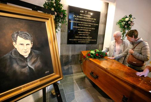 Honoured: Members of the public pay their respects at the remains of Fr John Sullivan after his beatification at St Francis Xavier's Church on Gardiner Street Photo: Damien Eagers