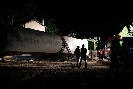 Rescuers stand near the site of a fatal train derailment close to the northern city of Thessaloniki, Greece on Sunday, May 14, 2017. (AP Photo/Giannis Papanikos)