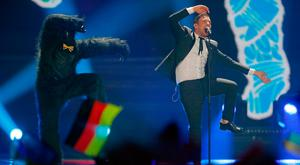 Francesco Gabbani from Italy, right, performs the song