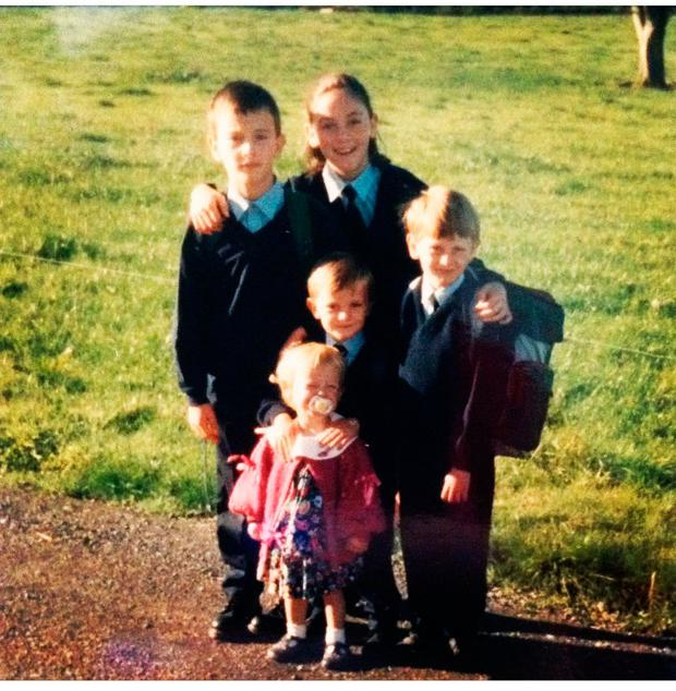 L-R: Paul, Claire, Aidan Darren and Irene at home in Durrow, taken on the morning of returning to school after summer holidays.