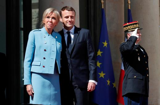 French President Emmanuel Macron and his wife Brigitte Trogneux stand on the steps of the Elysee Palace after the handover ceremony in Paris, France, May 14, 2017. REUTERS/Benoit Tessier