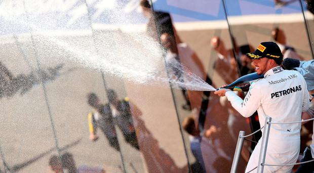 Lewis pips Vettel, wins Spanish GP