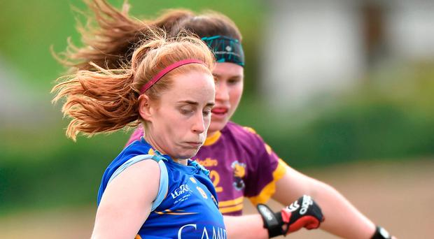 Niamh Lonergan of Tipperary in action against Niamh Mernagh of Wexford during the Lidl National Football League Division 3 Final Replay match between Tipperary and Wexford at St. Brendans Park in Birr, Co. Offaly. Photo by Matt Browne/Sportsfile