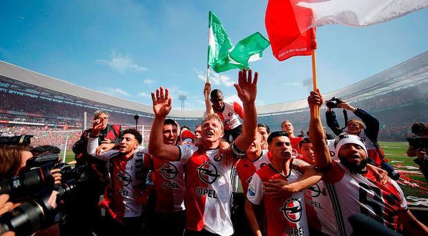 Dirk Kuyt of Feyenoord celebrates with team mates after winning the Dutch Eredivisie