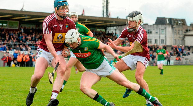 Damian Healy of Meath in action against Tommy Doyle and Gary Greville, right, of Westmeath