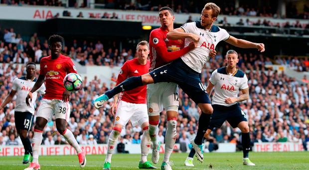Tottenham Hotspur's Harry Kane (front right) scores his side's second goal