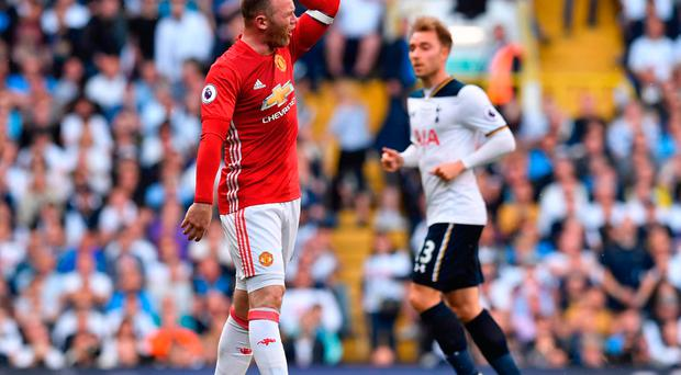 Manchester United's Wayne Rooney reacts during the English Premier League football match between Tottenham Hotspur and Manchester United at White Hart Lane