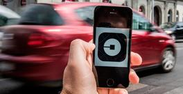 The Uber app connects passengers and drivers via smartphones Photo: Akos Stiller/Bloomberg