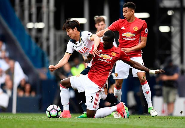 Tottenham's Son Heung-min battles against Manchester United's Eric Bailly and Jesse Lingard. Photo: Reuters