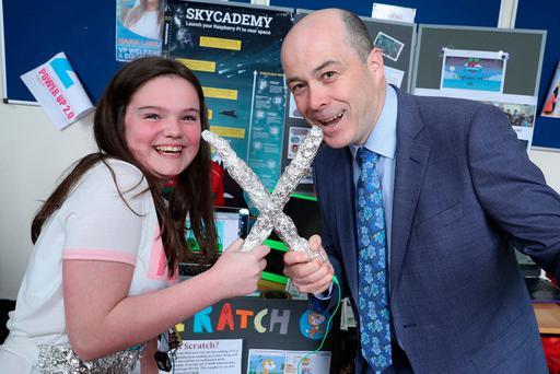 Anna Farragher (12) from Cloghan's Hill NS in Co Mayo shows Communications Minister Denis Naughten her Ninja Slayer game at the School Digital Champion Showcase at All Hallow's College in Drumcondra. Photo: Maxwells