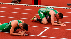 Ireland athletes Thomas Barr, Brian Gregan and David Gillick of Ireland reacts after after the Men's 4 x 400m Final on day five of the 23rd European Athletics Championships at the Olympic Stadium in Amsterdam, Netherlands. Photo: Brendan Moran/Sportsfile