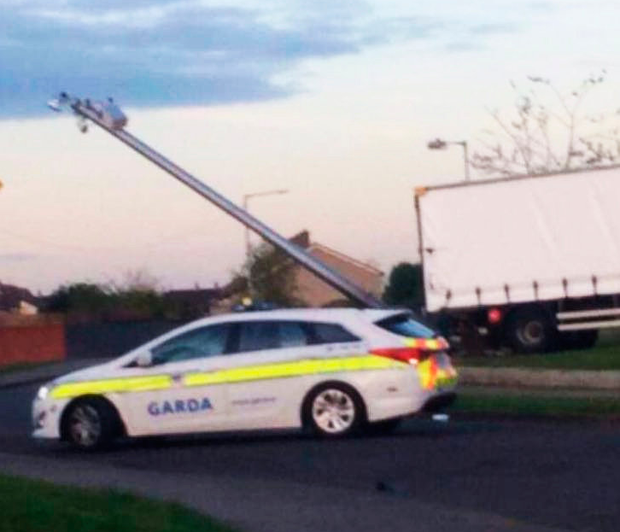 The damaged CCTV pole and the stolen truck that rammed it